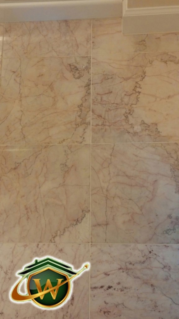 "43. 12""X12"" marble tile with Pink tones"