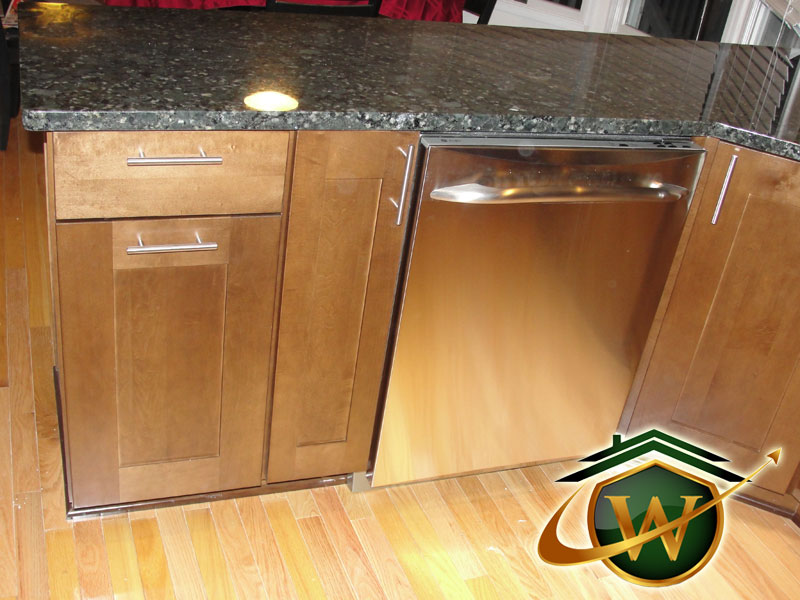 Dish Washer and Wooden Cabinets
