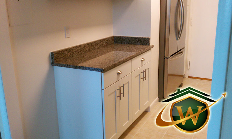 Kitchen Renovation - White Cabinets and Granite Countertops
